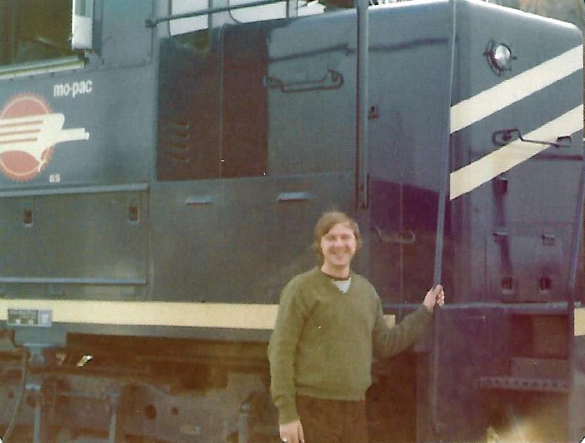 Locomotive Engineer Randy Smith in November 1974 next to a Missouri Pacific locomotive that took him on his regular route from Dupo, Illinois, to Poplar Bluff, Missouri.