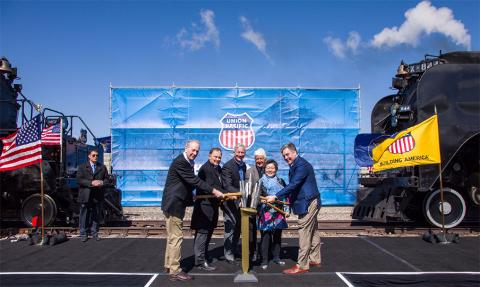 Tapping a ceremonial Golden Spike from left are Sandy Dodge, descendent of Gen. Grenville Dodge; Utah Gov. Gary Herbert, Union Pacific Chairman, President and CEO Lance Fritz, Utah Congressman Rob Bishop, Margarat Yee, a descendent of a Central Pacific employee, and Scott Moore, Union Pacific senior vice president-Corporate Relations and chief administrative officer.