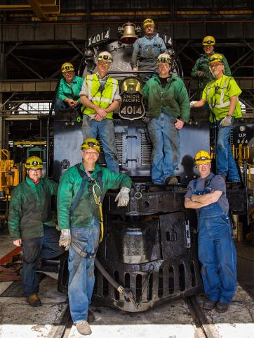 UP steam crew in front of No. 4014 locomotive.
