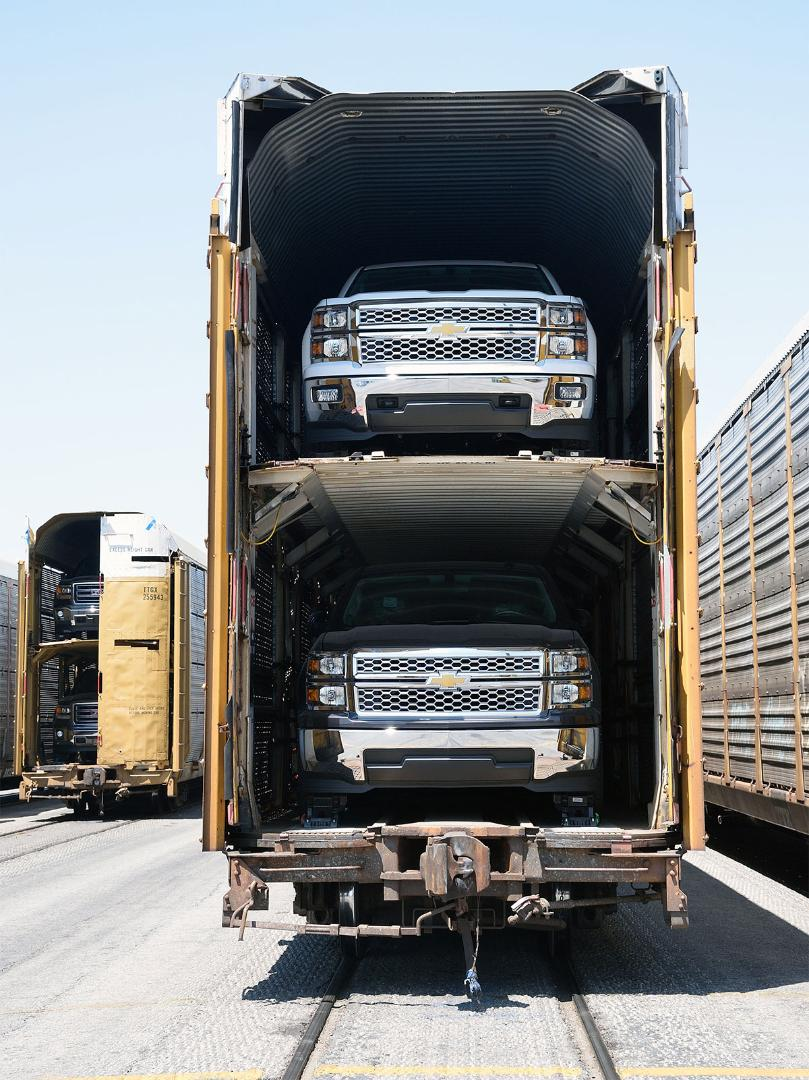 Vehicles wait to be unloaded at a Union Pacific auto facility.