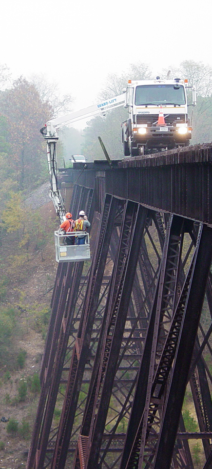 A snooper truck allows bridge inspectors to more easily and safely examine structures.