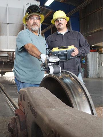 West Colton, California, Carman Welder John Moreno and Car Inspector Cesar Aguirre test a new wheel defect detector.