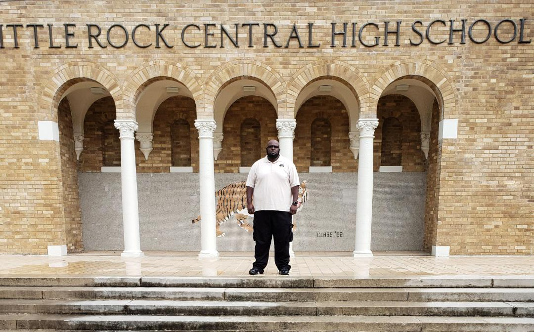 Union Pacifc locomotive engineer Harlee Watson stands outside his alma mater, Little Rock Central High School, one of the Open OutDoors for Kids locations supported by Union Pacifc.