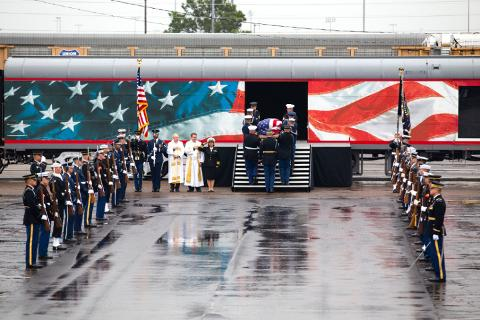 Small | President Bush's casket is carried aboard the funeral train.