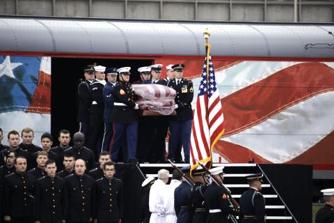 Small | President George H.W. Bush is carried off of the funeral train.