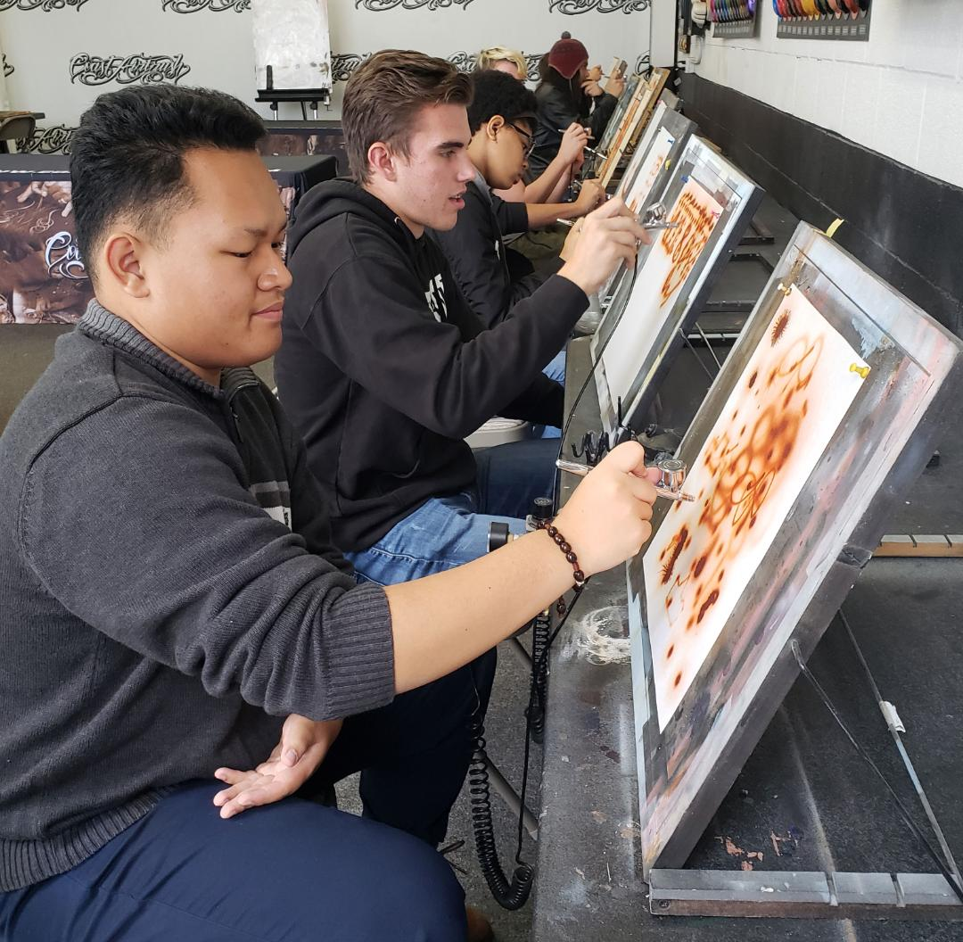 The students toured a local paint shop to see how automobiles get their color. Along the way, program participants were able to try their hand, testing out different painting techniques.
