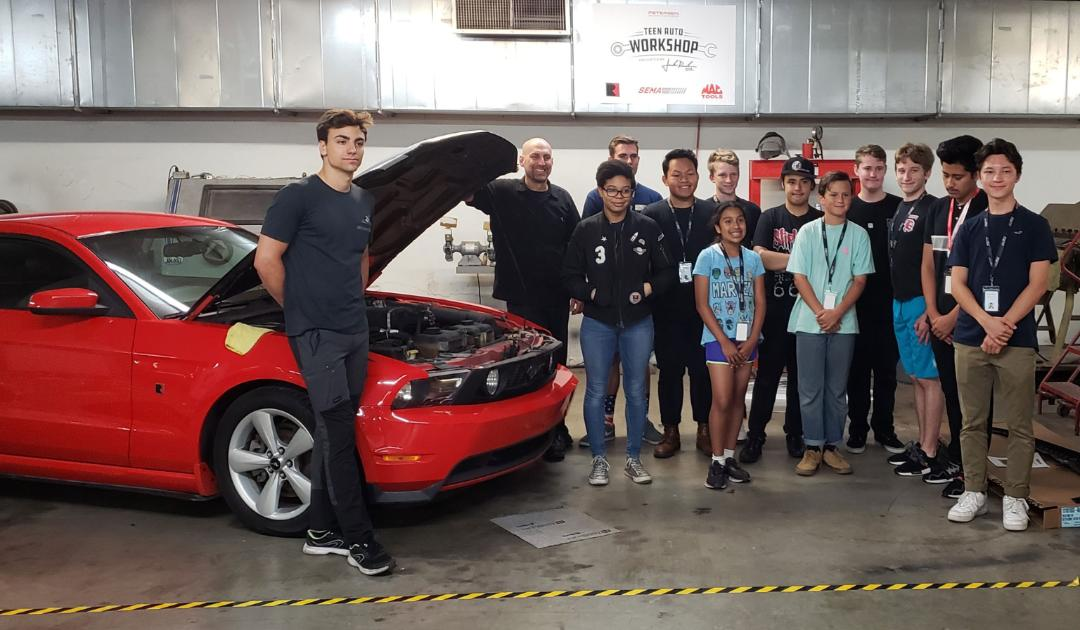 Teen Auto Workshop participants worked to upgrade a 2010 Ford Mustang.