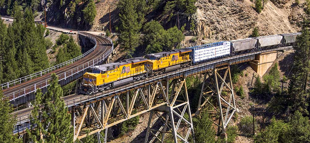 Building America Report 2016 - UP 7861 leads a manifest train across a bridge at Keddie, California.
