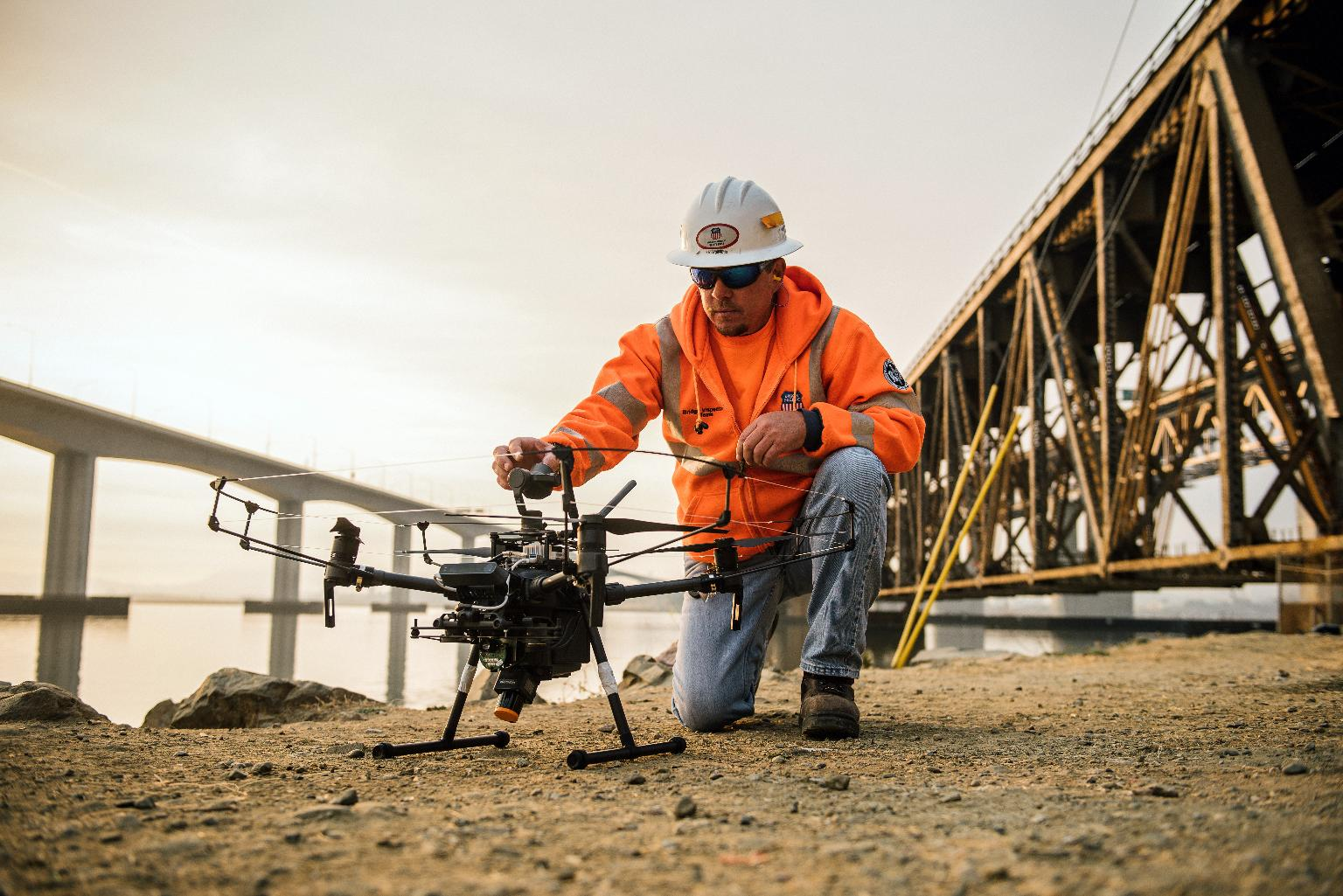 Large Retina | Bridge inspector George Otis with autonomous drone, California.