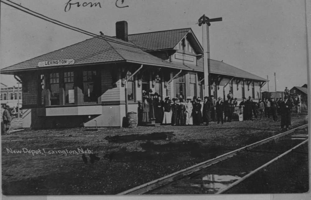 2ebdfcaa97f People posed in front of a new depot building in Lexington